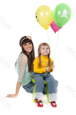 studio shot of mother and daughter with balloons
