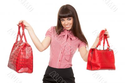 Portrait of a glamorous woman choosing bag
