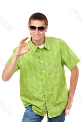 Casual portrait of a man in sunglasses and a green plaid shirt i