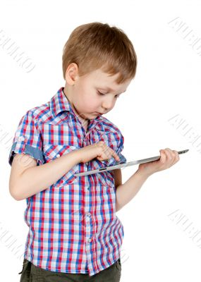 A boy in a plaid shirt with a tablet computer