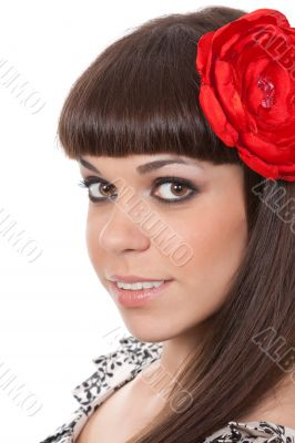Beautiful woman with fabric rose flower in her hair