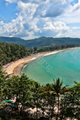 Tropical beach, in a cozy cove surrounded by hills