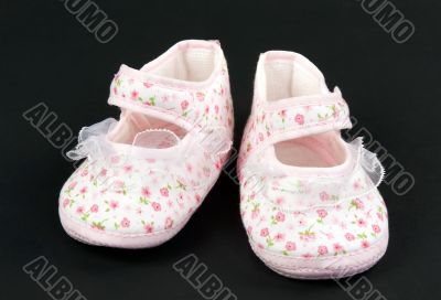 A pair of baby pink slippers