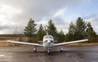 Small airplane parking - front view