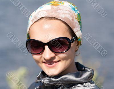 portrait of beautiful girl in the bandana and sunglasses