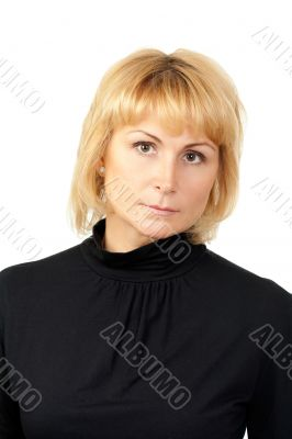 Portrait of a serious beautiful girl dressed in black