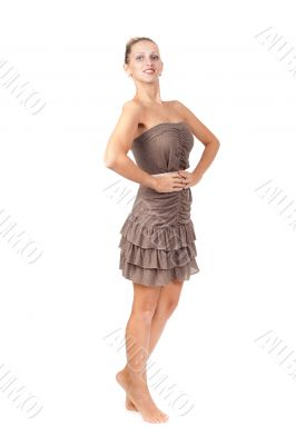 Charming slim girl in a brown dress in the studio