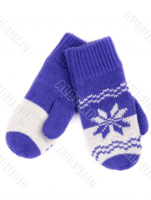 pair of knitted mittens with pattern snowflake