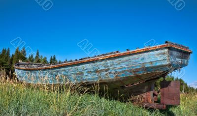 beached fishing trawler to give a well worn vintage look