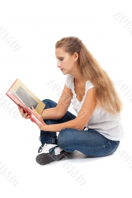 Girl in the lotus position to read the Book