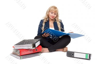 Beautiful girl sitting on the floor with folders for documents
