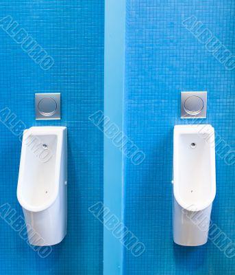 Men lavatory in modern building in a public restroom
