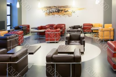 Interior of fashionable modern cafe with leather furniture