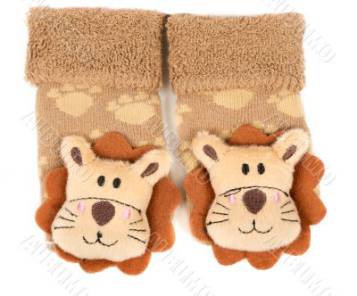 pair of children`s sneakers with a muzzle of a lion