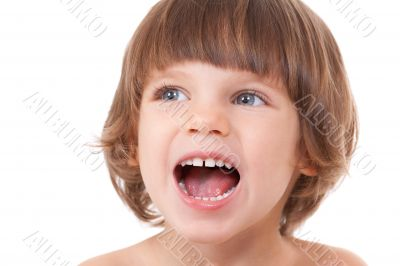 Studio portrait of a close-up of a girl with her mouth open with