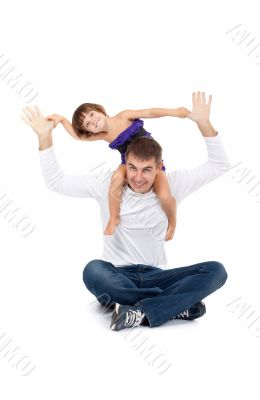 Cheerful daughter on the neck with his father in the studio
