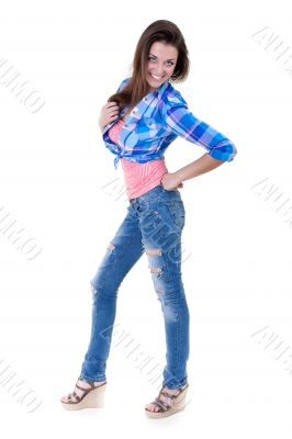 Glamorous young woman in shirt and jeans on white background