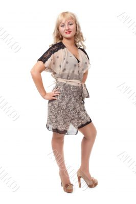 Full length portrait of trendy young woman in elegant beige dres