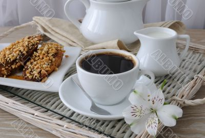 French toast with walnuts and cinnamon and a cup of coffee