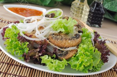 Rice noodles with mushrooms in breadcrumbs in lettuce leaves