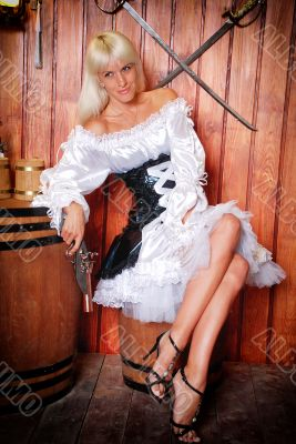 Attractive girl in a pirate costume in a tavern