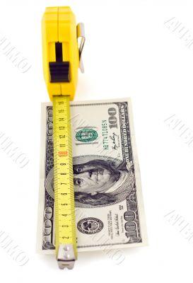 measure tape on hundred dollar