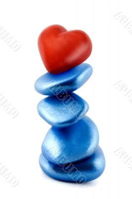 balance red heart in stone