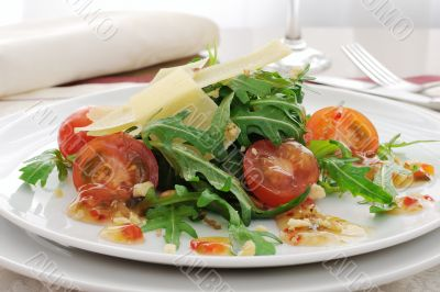 salad of arugula and cherry tomatoes with parmesan sauce