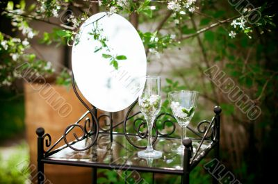 Table, mirror and glasses in the bush