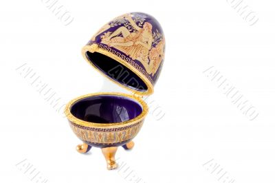 Casket in the form of an Easter egg with an ornament.ggggggggggg