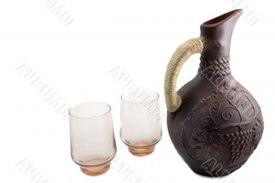 Ceramic jug for wine from red clay on a white background