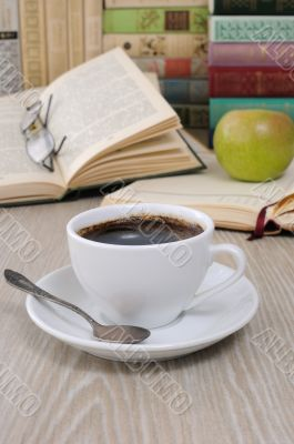 A cup of fragrant black coffee on the table against the backgrou