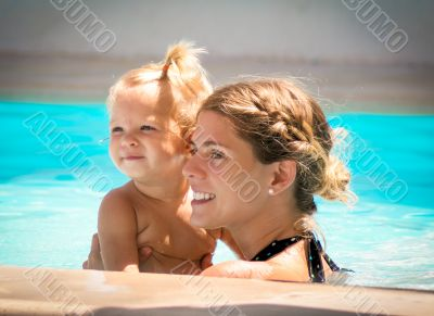 Mom and Daughter in the pool