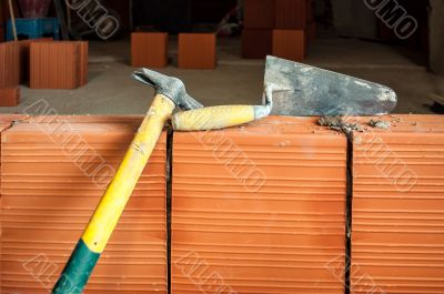 Hammer and trowel on construction site