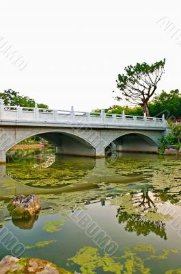 Reflection of chinese stone bridge