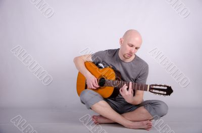 Nice bald guy with a guitar