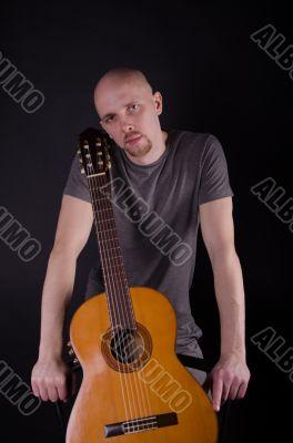 Nice bald guy with a guitar