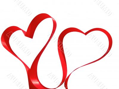 Two hearts made from red silky ribbon