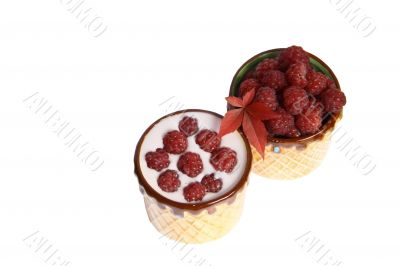 Berries raspberries and yoghurt in clay mugs on a white background