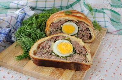 Meatloaf with egg and greens in the test