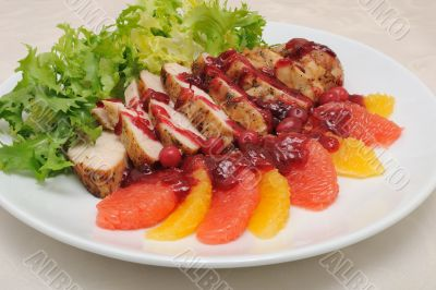 Sliced ​​baked fillet with cranberry sauce