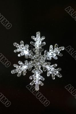 Christmas snowflake decoration on black background