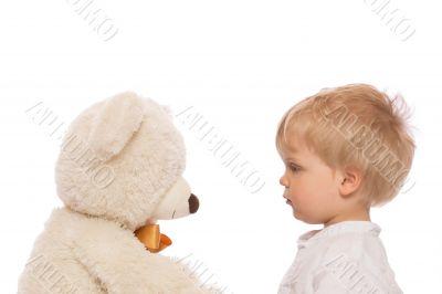 Cute child and teddy bear