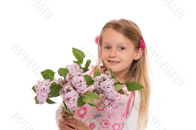 Happy little girl with lilac flowers