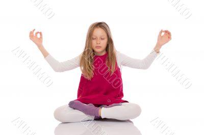 Young girl making yoga