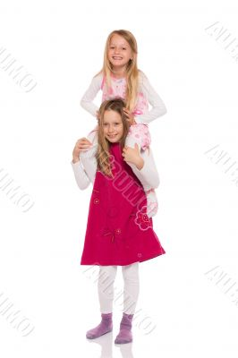 Young girl giving piggyback ride
