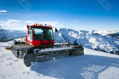 Snow-grooming machine on snow hill