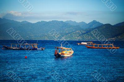 Boats in blue sea.