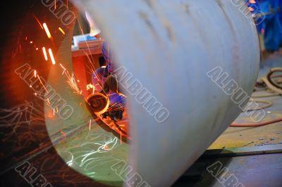 naval welder with protective mask welding metal