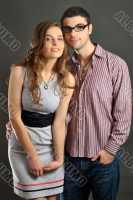 woman and man with magnetic jewellery shoot in studio
